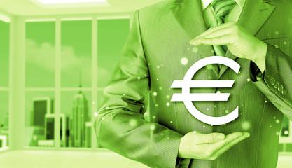 businessman protecting euro symbol