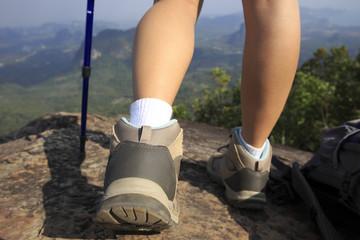 woman hiker enjoy the view on mountain peak rock
