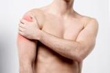 Muscular man discomfort on shoulder poster