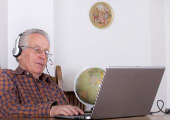 Senior man with laptop