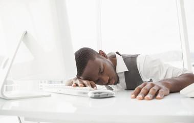 Tired businessman sleeping on keyboard
