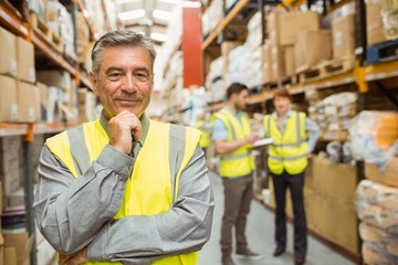 Portrait of smiling warehouse manager