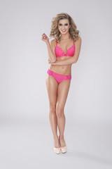 Tempting woman in pink underwear