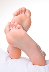 Men a foot and a heel on a white background