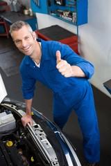 Mechanic looking up at camera