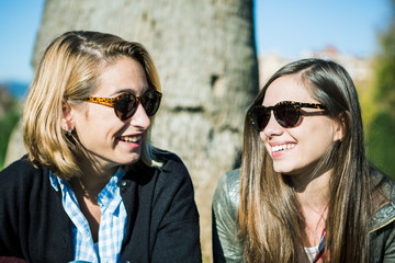 Two girls smiling at outdoors