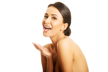Portrait of nude woman laughing loud, looking at the camera