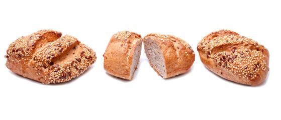 Fresh whole grain bread cut in half on white background