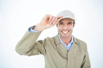 Portrait of happy delivery man holding cap