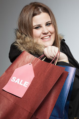 Plus size woman shopping on sales