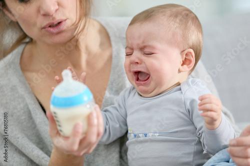 Leinwandbild Motiv Baby boy crying to have food