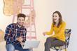 canvas print picture - Junger Mann mit Laptop und lachende Frau