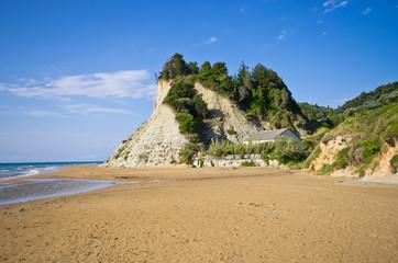 Beach and steep cliffs near Agios Stefanos, Corfu island, Greece