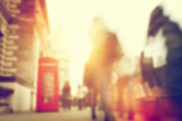People rush on a busy street of London. Blur, defocused