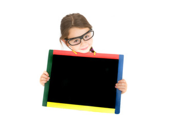 Smiling school child holding a chalkboard