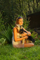 A young beautiful woman holding lovingly a stray dog