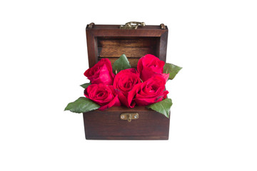 A red rose in an old wood chest