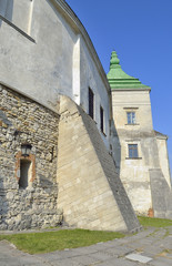 stony fortress wall and tower with blue sky background