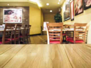 Wooden Table top with Restaurant Background