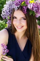 Girl with wreath of lilac flowers, spring time