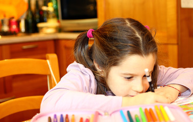 cute little girl writes on her notebook 2