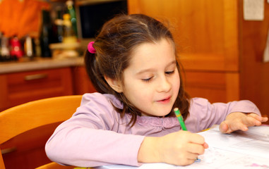 cute little girl writes on her notebook 10