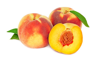 Two whole and a half peaches with green leaves (isolated)