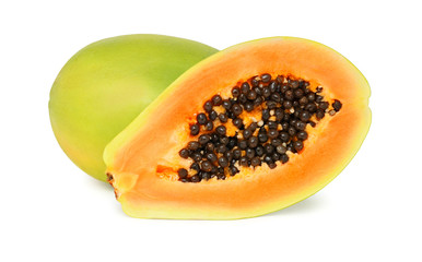 One whole and a half ripe papaya (isolated)