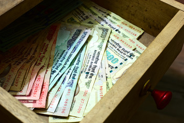 Indian rupees in table drawer