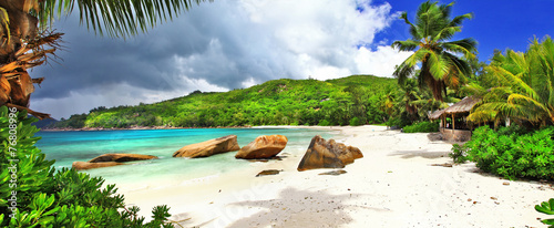 tropical holidays in Seychelles , panoramic view of Takamaka bea