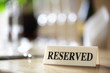Reserved sign on restaurant table - 76809582