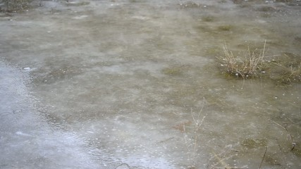 Puddle on ice with water stirred by wind