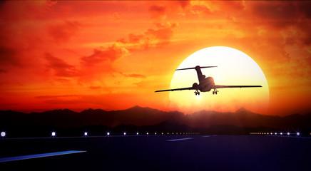 big jet passenger plane fly up over take-off runway