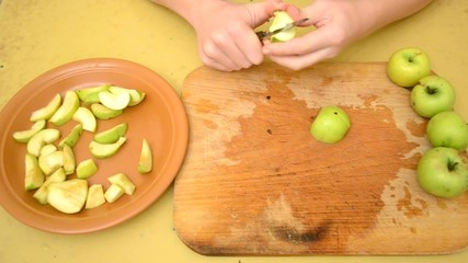 Removing apple kernels and cutting apples to slices