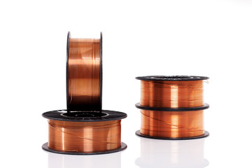 Copper welding wire in spools isolated