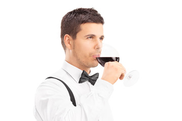 Young man enjoying a glass of red wine