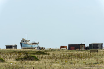 fish boat aground and sheds at Dungedness
