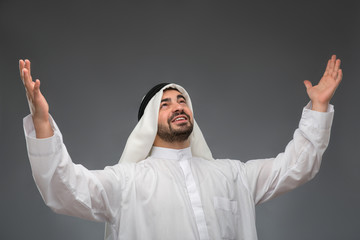 Arab businessman raising his hands