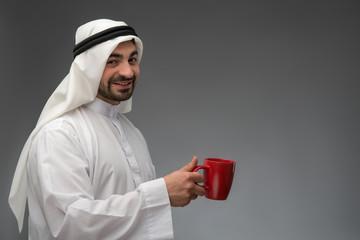 Happy Arab man having coffee break