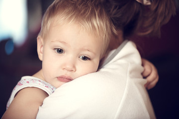 Closeup portrait of cute little boy with his mother.