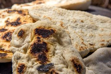 """Tabun"" a traditional way of making daruze pita bread"