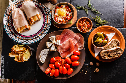 canvas print picture Spanish dinner cooked and served on the table