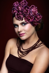 Beautiful young woman with artificial rouses on head necklace an