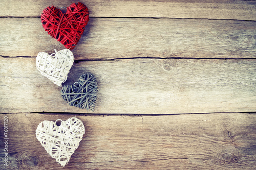 Heart on a wooden background. Vintage style. - 76817120