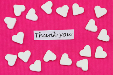 Thank you card with sugar hearts on pink background