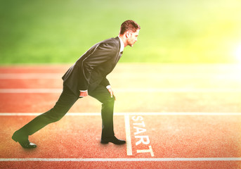 businessman standing on running track
