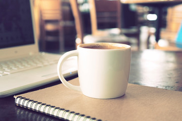 vintage color tone of  cup of coffee  on the table coffee shop