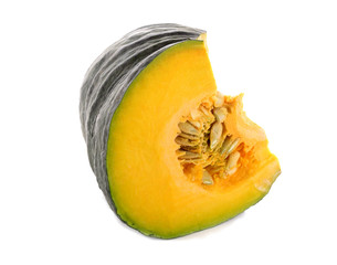 piece of fresh pumpkin with seeds on white background