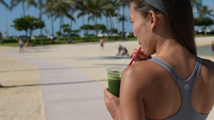 Woman drinking vegetable Green detox smoothie