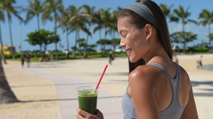 Green detox smoothie - woman drinking vegetables